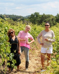 Women Wine Tasting in Vineyard